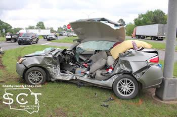 The Ford Focus involved in Sunday's wreck is seen above after Jaws of Life was used to cut into the vehicle.