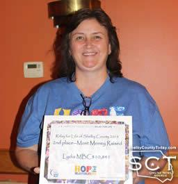 Lydia MBC team wins 2nd Place for Most Money Raised. Pictured is Amy Oswalt accepting the award.