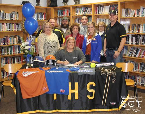 Kaylie Bush is pictured above with family and coaches on signing day in the Timpson ISD Library.