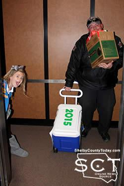 Girl Scout Ella Matthews delivering cookies with the help of her dad. She is the daughter of Jim Ed and Jennifer Matthews.