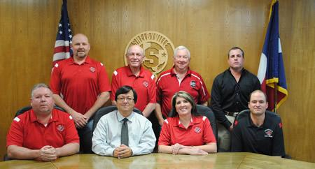 SISD School Board Members pictured are: (Front row, L to R) Tim Bradshaw, 2 years; Dr. Ray West, Superintendent; Etola Jones, President, 7 years; Mark Bohannon, Vice-President, 2 years; (back row, L to R); Joey Lawson, Secretary, 3 years; Duane Lout, 4 years; Joe Tom Schillings, 7 years; and Kelly Parker, 9 years.
