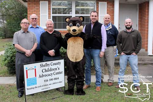 From left: Don Walker, Dr. Keith Miller, County Attorney Gary Rholes, Happy Bear, Luke Garrett, Jim Sawyer, and Wil Blackshear
