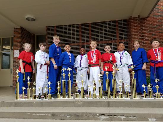 Left to right; Hollie Hamilton 1st in Forms and 4th in Chanbara, Ethan McElroy 2nd in Forms, 3rd in Weapons, 4th in Sparring and 5th in Chanbara, Samuel Brazzel 5thf in Weapons, 4th in Forms and 3rd in Chanbara, Maximus Rojas 1st in Forms, 1st in Sparring and 5th in Chanbara, Aiden Wallace 2nd in Grappling, 5th in Forms and 5th in Chanbara, Hunter Cooper 5thf in Weapons, 4th in Sparring, 2nd in Chanbara and 3rd in Forms, Logan Galindo 1st in Weapons, 1st in Forms, 3rd in Chanbara and 4th in Sparring, Aiden Hughes 1st in Grappling, 5th in Forms and 5th in Chanbara, Brittany LaValle 4th in Sparring and 4th in Chanbara,  and Jaxon Sanford 4th in Forms, 4th in Chanbara and 5th in Sparring.  Students not in Photo are Eric Mendoza 4th in Forms, Justyn Morris 4th in Forms and 5th in Sparring and Brooklynn Scates 3rd in Grappling and 5th in Forms. Coaches were Master T. Roddy and Sensei R. Roddy. Thanks to the Parents for supporting your children during this competition!