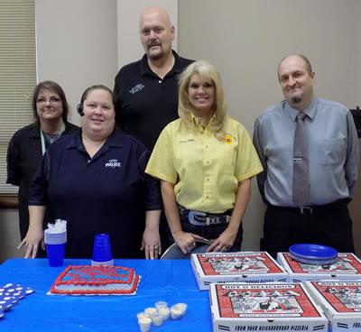 From left: Jolene Tindol, Amy Lindley, Police Chief Jim Albers, Communications Supervisor Donna Duggar, and Daniel Williamson. All photos by Lisa Albers.