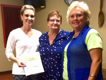 From left: Anna Lee presents donation to Brown and Judy Stegall of Empty Arms