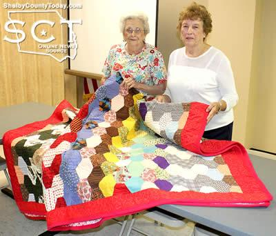 Bobbie Nutt (left) sold Odessa Link (right) the winning ticket for the quilt.