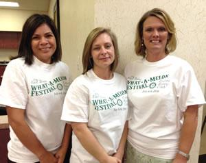 Shelby Savings Bank employees modeling the 2016 What-A-Melon Festival T-Shirts