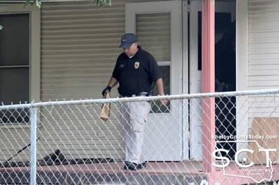 Center Police Detective David Haley is seen exiting 1160 Garrett Street in Center with an evidence bag.