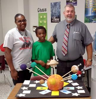 Pictured are (center) I'Morion McClelland, (right) Mike Furlow, S.W. Carter Elementary Principal and (left) Concynthia Garrett, I'Morion's Mom.
