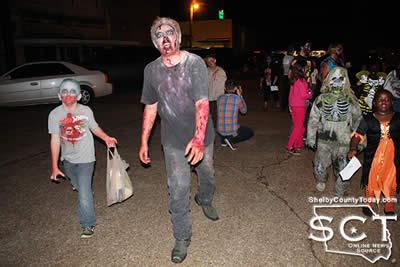 Zombies are seen above participating in the 1st Annual Zombie Walk in 2015.