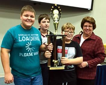 Middle School 1st place team (from left) Pacey Rhodes, Konner Barber, Michael Keller and Sponsor, Brenda Farmer
