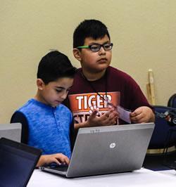 (From left) Jayden Beatriz and Jairo Hernandez programming their robot for competition.