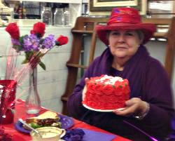 Judy Carrington and the birthday cake provided by The Little Fox Market Place.