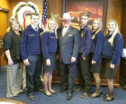 From left: teacher Kristin Powers, Connor Timmons, Macy Jo Hanson, Commissioner Sid Miller, Chase Clepper, Kayleigh Scroggins, and Amanda Yates.