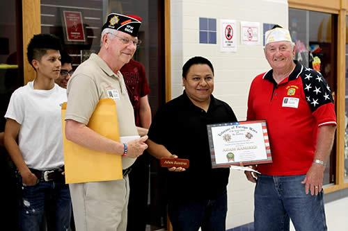 Post Commander Gene Hutto (red shirt) and Post Quartermaster Larry Hume present Adam with certificate, pen, and check.