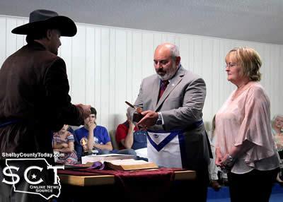 Worshipful Master Jimmy Wagstaff (left) presents Vance Jordan with the Golden Trowel Award.