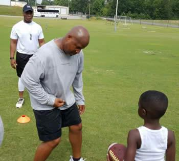 John Preston (foreground) shows some moves to Preston campers while Ronnie Williams waits his turn.