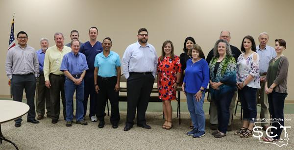 Rotary members and Shelby County Children's Advocacy Center staff stand together to raise funds.