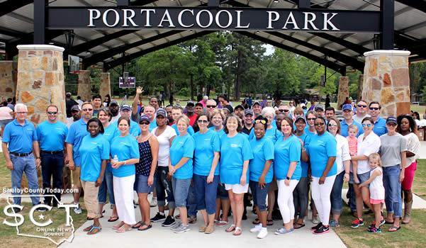 Portacool employees and representatives gathered before the Portacool Park entrance.
