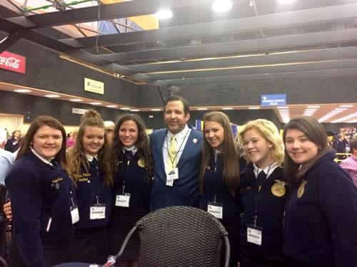 Pictured are (from left): Jaylee Sims, MaKayla Mayo, Maddie Russell, Texas FFA Foundation board member Victor Guerra, Madison McMillian, Gracie Clifton, Carsen Vickers.