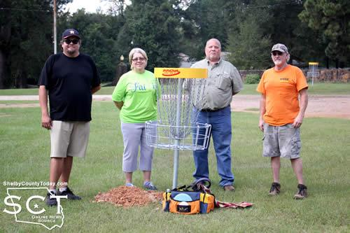 Pictured are (from left) Kyle Allen; Debra Smith, Timpson mayor; Paul Smith, Timpson Area Chamber of Commerce President; and Craig Lewis, Disc Golf course designer.