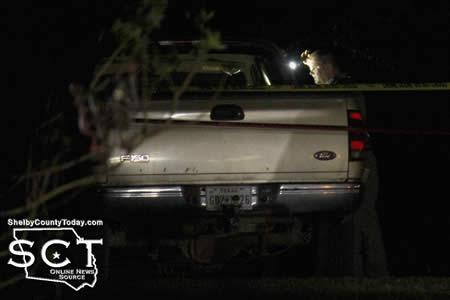 Texas Ranger James Hicks is seen peering into the apparent suspect vehicle involved in the chase before the driver exited the vehicle.