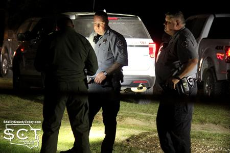 Texas Ranger James Hicks (left) is seen speaking with Shelby County Sheriff's Deputies Jeff Gogolewski (middle) and Cody Muse (right).