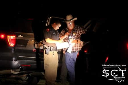 Tenaha City Marshal Jacob Samford (left) and Roy Cheatwood, Precinct 3 Constable, confer with one another at the scene.