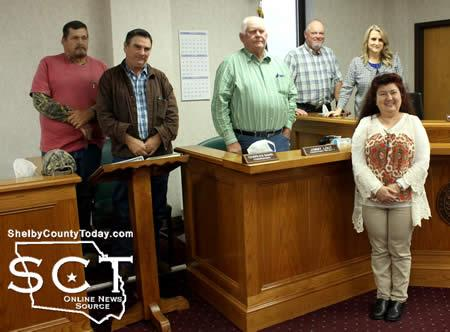 Martha Ventura (front) is a Panola College student of governmental studies. As part of her class she was to attend a local government meeting and following the Commissioners' Court the officials posed with her for a photo.