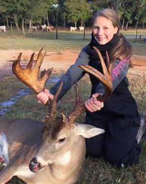 Lady hunter Chloe Howard of Bullard displays the 21-point bruiser she brought down while hunting with her uncle, Clint Miller, of Jacksonville. She was hunting on 100 acres of open range in Nacogdoches County. (Photo courtesy of Clint Miller)