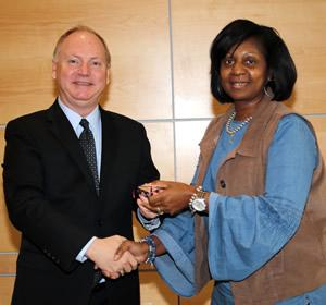 Dr. Greg Powell congratulates Dazell Hicks for 35 years of service. (Not pictured: Dr. Bob Wilkins.)