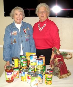 Golden Harvest Ministries Club 1st Vice President Linda Anderson and President Helen Collard are shown with can goods collected by members.