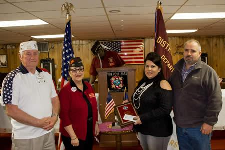 (Photo L-R, Post 8904 Commander Gene Hutto, State Senior Vice Commander Inge Conley who made the presentation, Jennifer and husband Randy.)