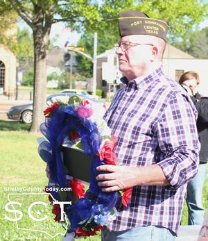 Mike Langford places the memorial wreath.