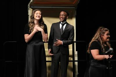 "Panola Pipers Sydnee Taylor, Funminiyi Alabi and Shannon James sing ""Love Will Keep Us Together."""