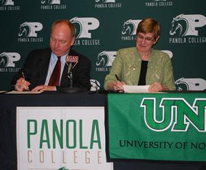 Dr. Greg Powell, Panola College president, signs an articulation agreement with the University of North Texas B.A.A.S. program faculty director, Dr. Peggy Shadduck.