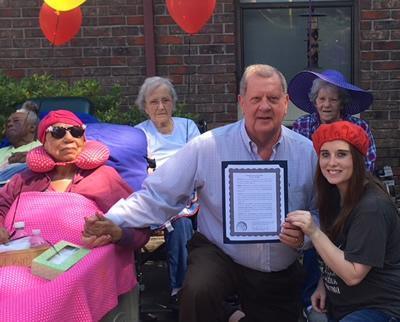 Mayor Chadwick holds the proclamation along with Skylar Hagler, Activities Director.