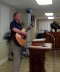 David Mathis playing his guitar