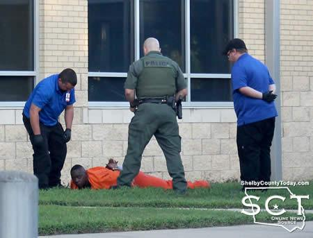 CPD Sgt. Chris Knowlton is seen with ACE EMS personnel and an inmate on the ground who had been tazed.