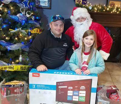 Carmella King was the winner of the toy drive raffle.