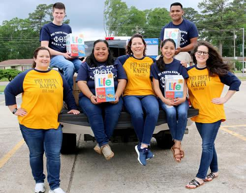 PTK students and faculty sponsors load donated cereal to deliver to Mission Carthage. From left, back row, are Mitchell Fountain and Mauricio Robles; front row, Chasity Klingler, Milagros Luna, Roberta Collinsworth, Esther Hernandez and Emily Zabcik.