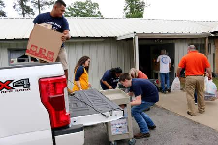 Volunteers helped PTK students and sponsors unload the boxes of cereal at the Mission Carthage building on U.S. Highway 79 North.