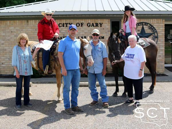 """Pictured are (from left):  Pam Woodfin, Gary City Secretary; Danny Dixon on """"Pepper,"""" Cody Pierce, John Patty, Sarah Dixon on """"Gypsy,"""" and Marilyn Corder."""
