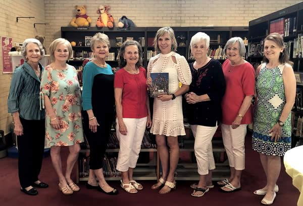 Pictured (from left) are Reading Club members, Fannie Watson, Sue Russell, Donna Holt, new club President Dottie West, retiring club President Deborah Chadwick, Polly Smith, Billie Sue Payne, and Monte Jones.