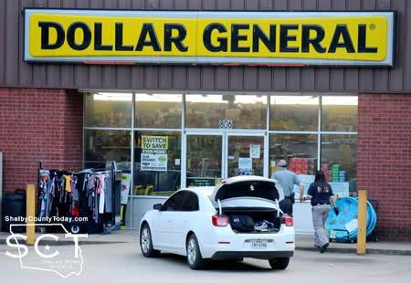 Center PD Sgt. Detective Nicole Faulkner and Detective Andrew Williams are seen entering the Dollar General to work their investigation of the incident.