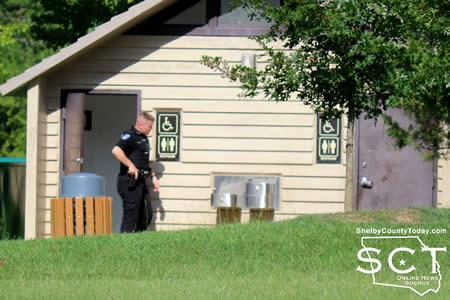 Center Police Officer Brian Wright is seen checking bathrooms at the Center Mini Park for the possible suspect.