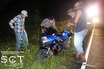 DPS Trooper Ricardo Segura investigated the Suzuki 600 motorcycle following the incident. He is seen being assisted by Gene Vail and his wrecker crew.
