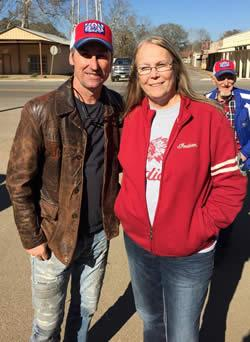 Debbie Leggett, (right) is seen with American Pickers star Mike Wolfe (left) during filming in Joaquin.