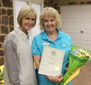 (Left) Jackie Hancock present Doggett with lifetime membership award for District III, Texas Garden Clubs.