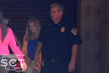 Jenny Rhodes-Cassell is seen being escorted into the Shelby County Jail by Center ISD Police Chief Pete Low and Center Police Detective Nicole Faulkner.